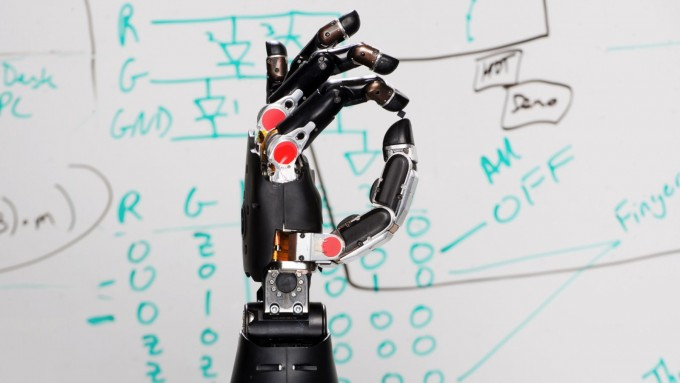 mind-controlled-prosthetic-robot-arm-feel-touch