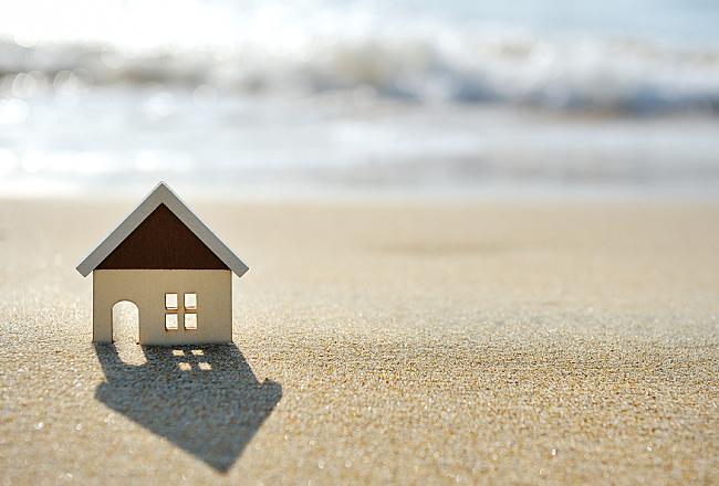 little house on the sand beach near sea