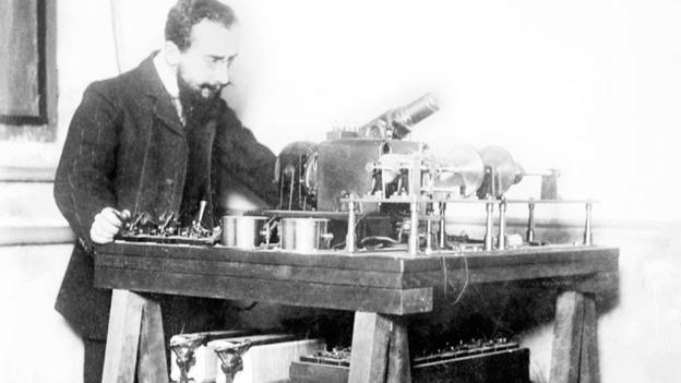 ^BBelin with his fax machine.^b French inventor Edouard Belin (1876-1963) with his telephotograph machine